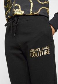 Versace Jeans Couture - Spodnie treningowe - black - 5