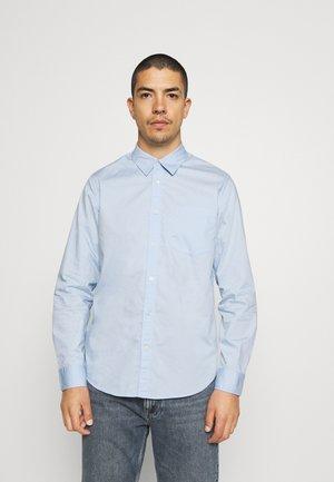Košile - blue light