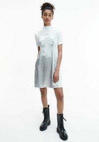 Calvin Klein Jeans - METALLIC SATIN SLIP - Cocktail dress / Party dress - silver - 1