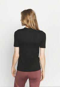 Under Armour - T-shirt sportiva - bamboo - 2