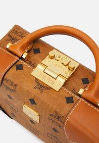 MCM - SOFT BERLIN VISETOS CROSSBODY SMALL - Across body bag - cognac - 3