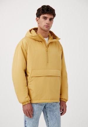 ÜBERGANGS - Winter jacket - mustard