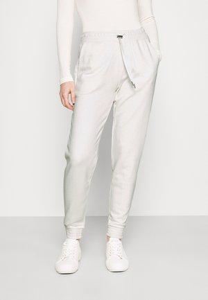 JOGGER REGULAR - Verryttelyhousut - off white
