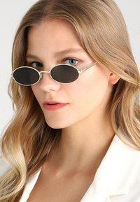 Le Specs - LOVE TRAIN - Sunglasses - bright gold - 1