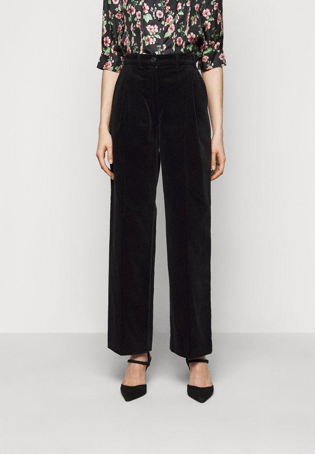 LUCAS - Trousers - black