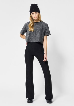 CINDY SHORTY - Trousers - black