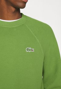 Lacoste - Collegepaita - tax - 5