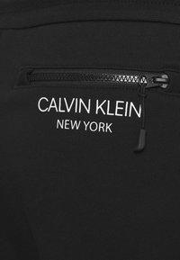 Calvin Klein - ELEVATED - Tracksuit bottoms - black - 2