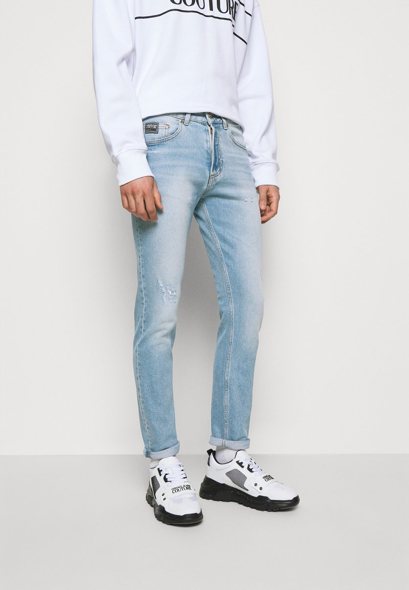 Versace Jeans Couture - AMETIST - Slim fit jeans - light blue denim