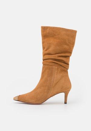 SARA - Classic ankle boots - sella