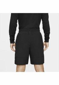 Nike Performance - FLEX SHORT - Träningsshorts - black mean green - 2