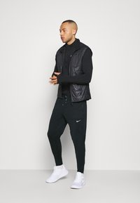 Nike Performance - ELITE PANT - Jogginghose - black/black/reflective silver - 1