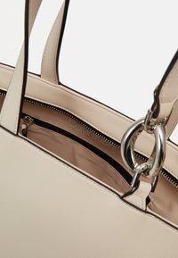 Calvin Klein - CHAIN SHOPPER - Handbag - beige - 4