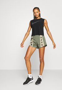 Nike Performance - RUN TANK PLEATED - Sports shirt - black/reflective black - 1