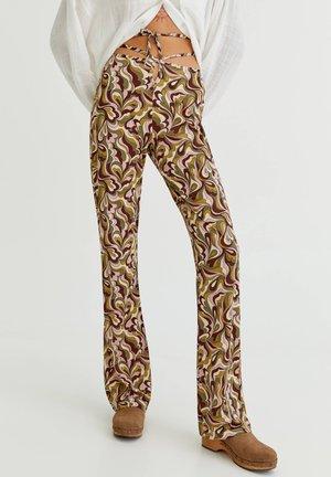 MIT RETRO-PRINT - Trousers - green