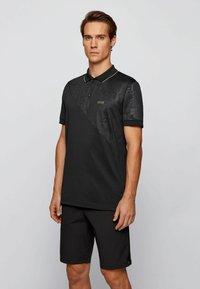 BOSS - Polo shirt - black - 0