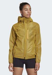adidas Performance - TERREX AGRAVIC RAIN JACKET - Waterproof jacket - gold - 0
