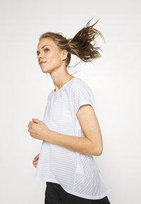 Puma - BE BOLD TEE - Print T-shirt - white - 4