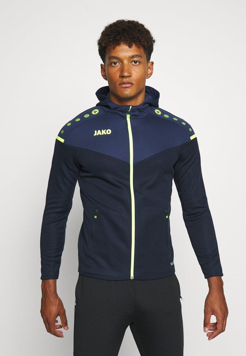 JAKO - CHAMP - Training jacket - marine/blue/neongelb