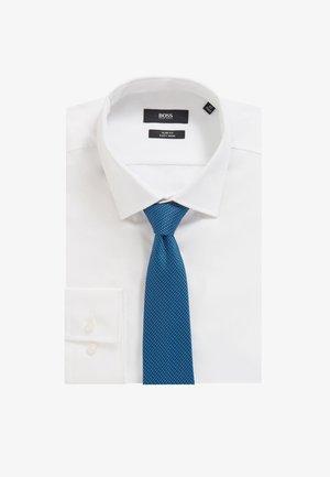 TRAVELLER - Tie - blue