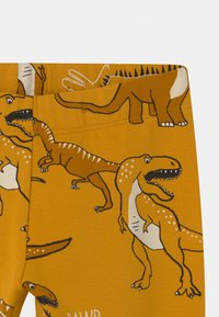 Lindex - MINI DINO UNISEX - Tracksuit bottoms - dark dusty yellow - 2