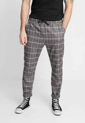 CHRISTIAN - Trousers - grey/red