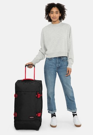 TRANVERZ M BLAKOUT - Wheeled suitcase - black/red