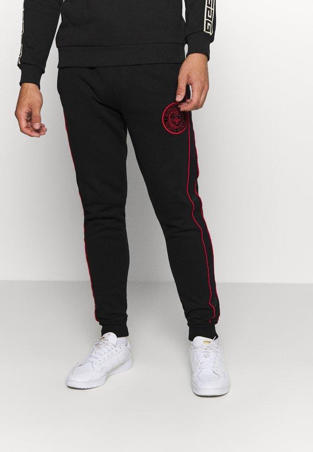 JAVAN - Pantalones deportivos - black