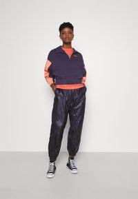 Nike Sportswear - HOODIE - Sweatshirt - dark raisin/crimson bliss/bright mango - 1