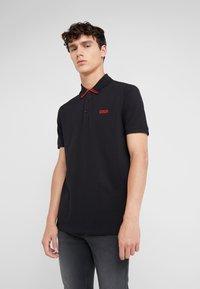 HUGO - DYLER - Polo shirt - black - 0