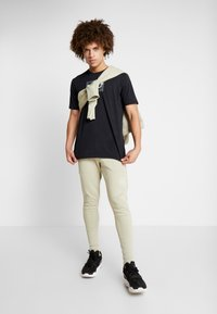Under Armour - SC30 OVERLAY SS TEE - Print T-shirt - black/white - 1