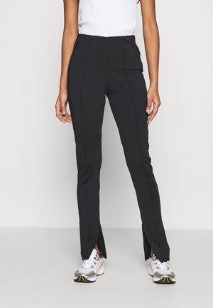 SPLIT HEM - Leggings - Trousers - black