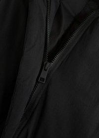 Mango - WATERAFSTOTENDE BODY WARMER - Vest - zwart - 5
