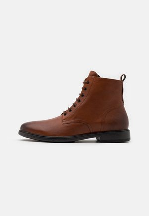 TERENCE - Lace-up ankle boots - cognac
