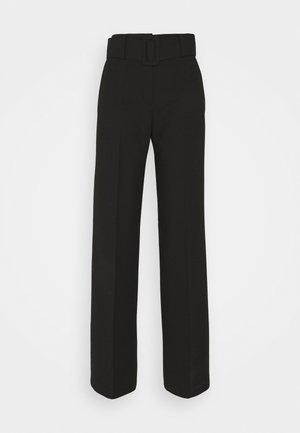 HULEA - Trousers - black