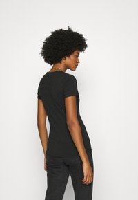 Tommy Jeans - SKINNY STRETCH V NECK - Basic T-shirt - black - 2