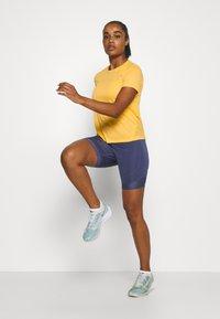 Nike Performance - MILER - T-shirt print - topaz gold/reflective silver - 1