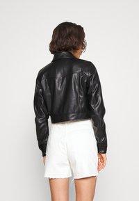 ONLY - ONLVIBE TRUCKER JACKET - Faux leather jacket - black - 2