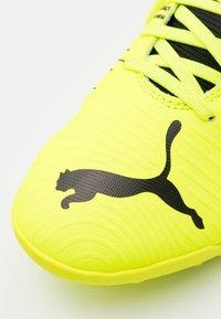 Puma - FUTURE Z 4.1 TT - Astro turf trainers - yellow alert/black/white - 5