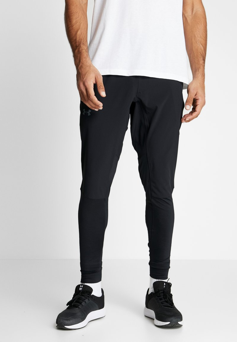 Under Armour - HYBRID - Tracksuit bottoms - black/pitch gray