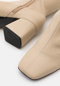 Monki - ARIANNE BOOT VEGAN - Over-the-knee boots - beige - 5