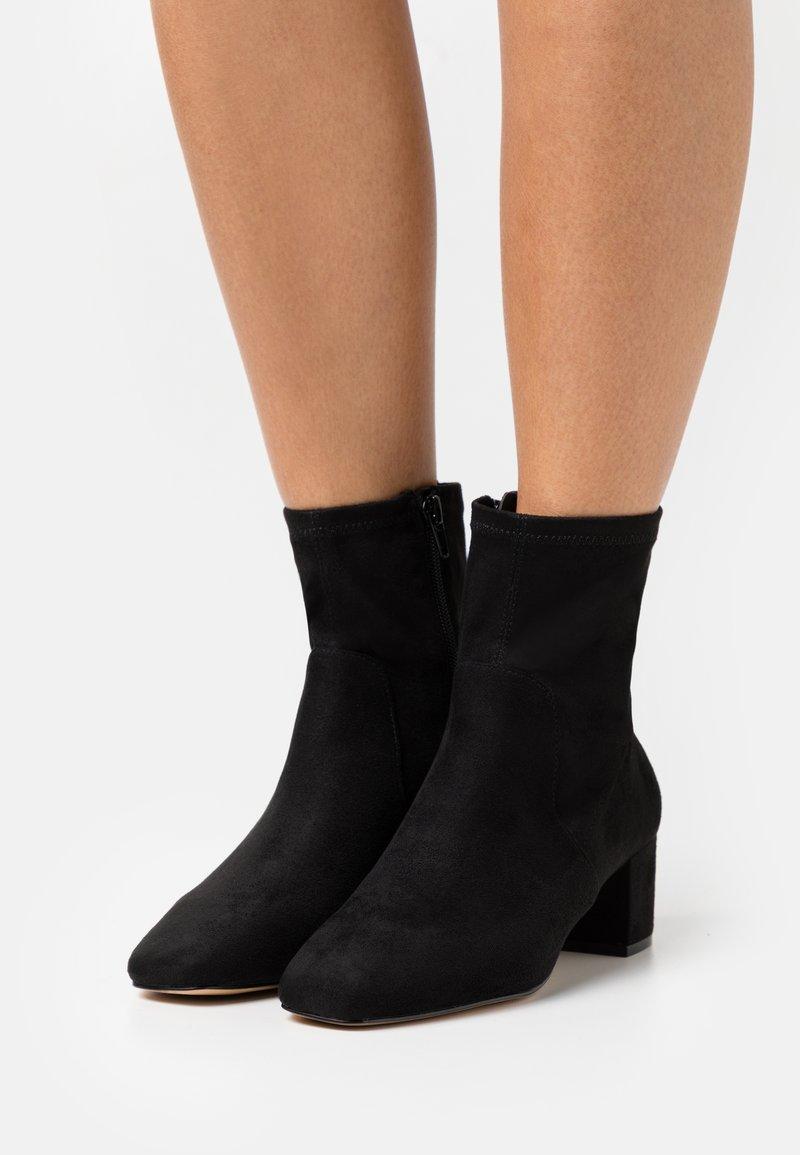 ALDO - MYAII - Kotníkové boty - black