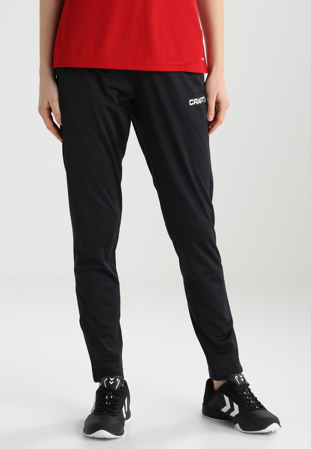 PROGRESS PANT - Verryttelyhousut - black