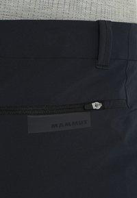 Mammut - RUNBOLD PANTS  - Pantalon classique - black - 4