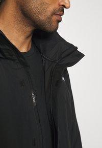 adidas Performance - FOUNDATION RAIN.RDY HIKING JACKET - Hardshell jacket - black - 7