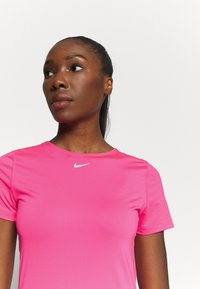 Nike Performance - ALL OVER - Basic T-shirt - hyper pink/white - 3