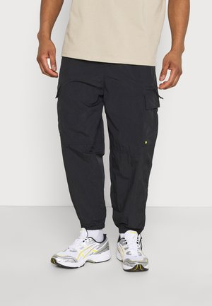 SCOTTIE BAGGY JOGGERS UNISEX - Tracksuit bottoms - black