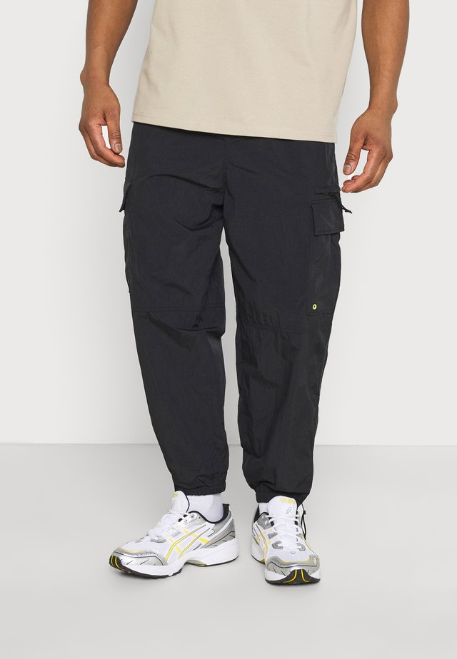 SCOTTIE BAGGY JOGGERS UNISEX - Trainingsbroek - black