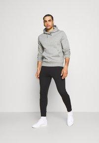 Calvin Klein Golf - PLANET - Pantaloni sportivi - black - 1