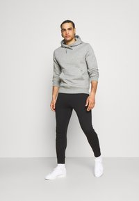 Calvin Klein Golf - PLANET - Pantalon de survêtement - black - 1